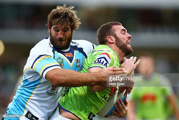 David Taylor of the Titans tackles Mark Nicholls of the Raiders during the round nine NRL match between the Canberra Raiders and the GOld Coast...