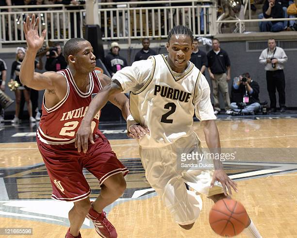 David Teague drives against A J Ratliff for 2 of his 32 points in Purdue's 81-68 win over Indiana at Mackey Arena in West Lafayette, Indiana on...