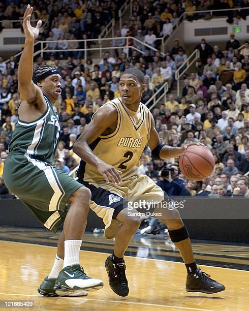 David Teague looks for room around Shannon Brown in the second half of Purdue's 76-70 win.