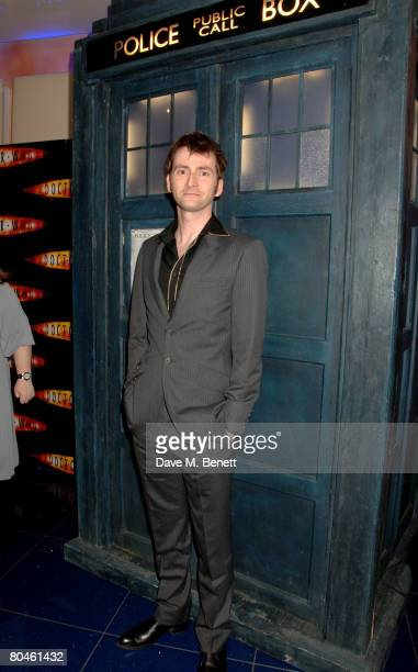 David Tennant poses in front of the Tardis during the press launch of 'Dr Who' Series 4 at the Apollo West End on April 1 2008 in London England The...
