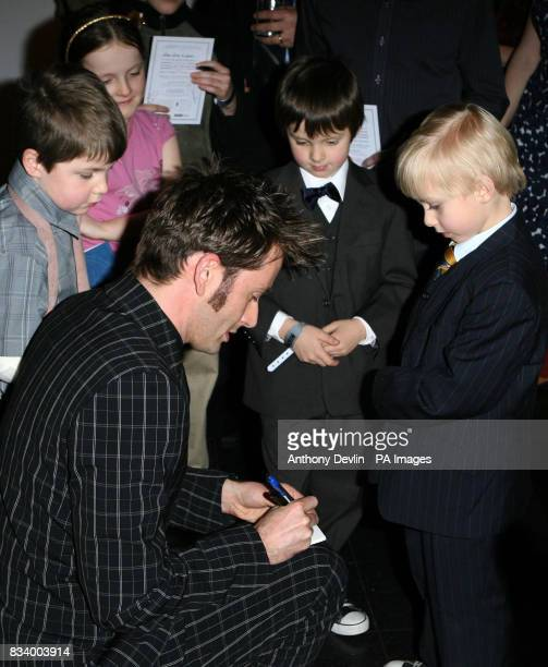 David Tennant signs autographs at the Gala Screening of the Doctor Who Christmas espisode at The Science Museum in west London