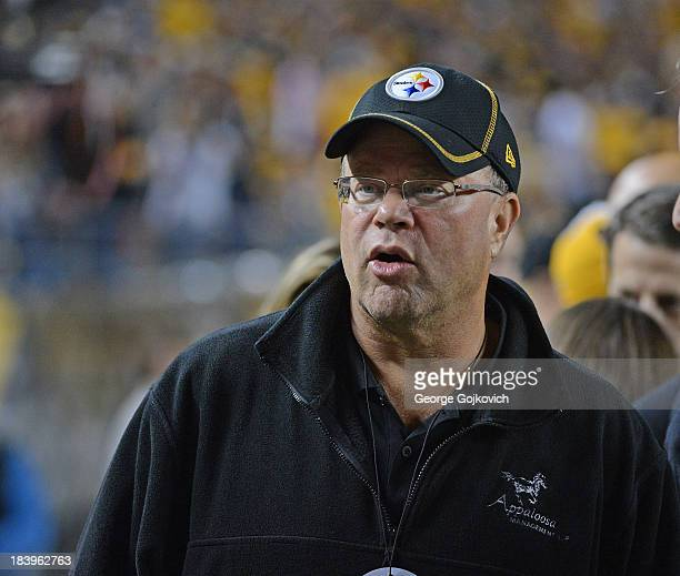 David Tepper president of Appaloosa Management and a minority owner of the Pittsburgh Steelers looks on from the sideline before a game between the...