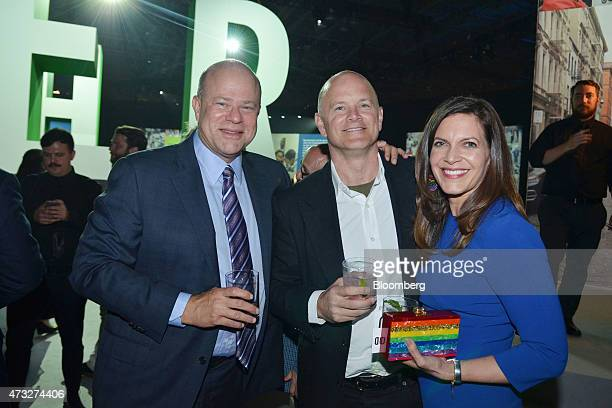 David Tepper president of Appaloosa Management LP from left Mike Novogratz founder of Fortress Investment Group LLC and Sukey Novogratz stand for a...