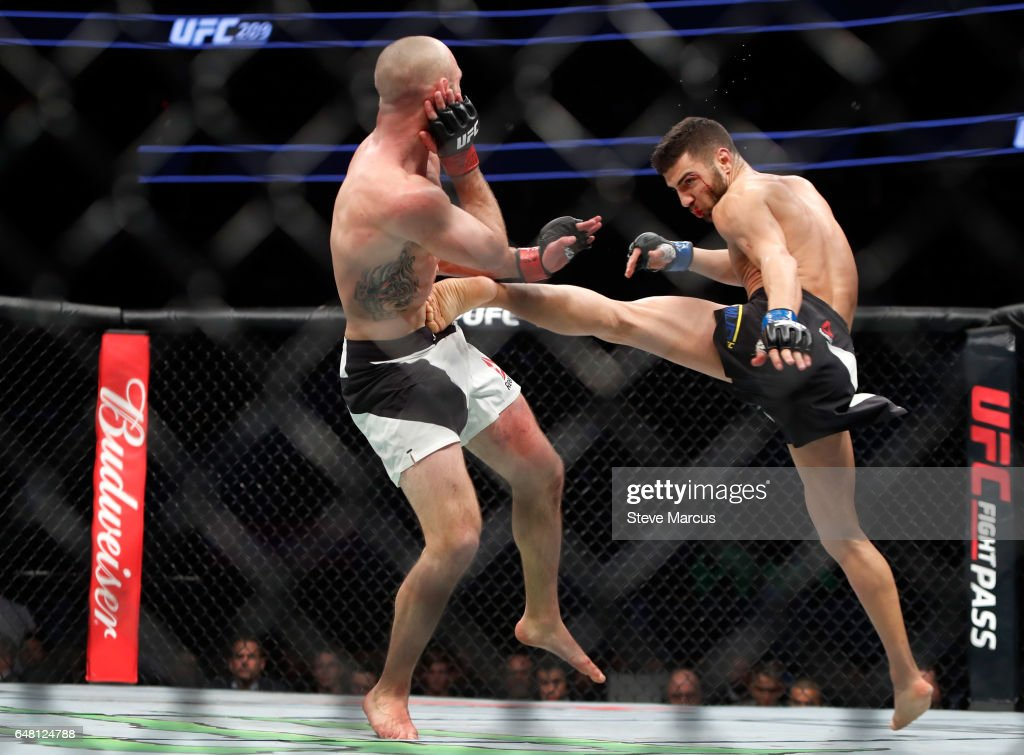 David Teymur (R) of Sweden kicks Lando Vannata in a lightweight bout during UFC 209 at T-Mobile Arena on March 4, 2017 in Las Vegas, Nevada. Teymur won the bout by unanimous decision.