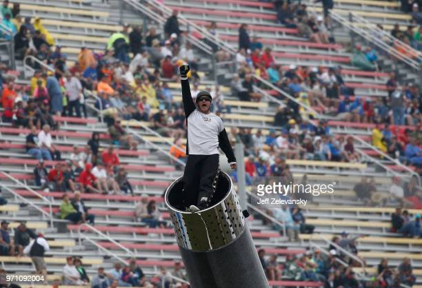 David The Bullet Smith is shot out of a cannon during prerace festivities for the Monster Energy NASCAR Cup Series FireKeepers Casino 400 at Michigan...