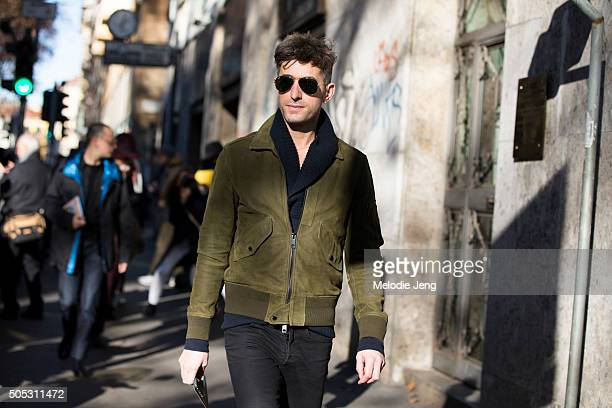 David Thielebeule of WSJ journal weasr a green suede bomber jacket with pocket during the Milan Men's Fashion Week Fall/Winter 2016/17 on January 16...