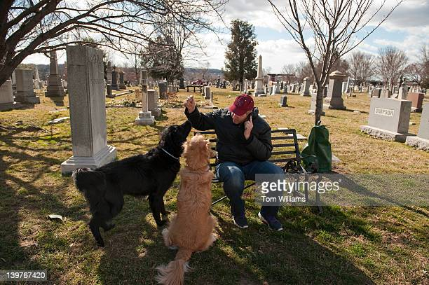 David Thomas tends to his dogs Jackson left and Henry in Historic Congressional Cemetery in Southeast Dog owners are able to become members of the...