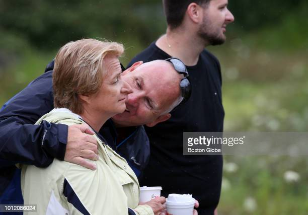 David Thompson comforts his wife Steliane while taking in the view of Main Street with their son Bill in Webster MA on Aug 4 2018 Steliane's parents...