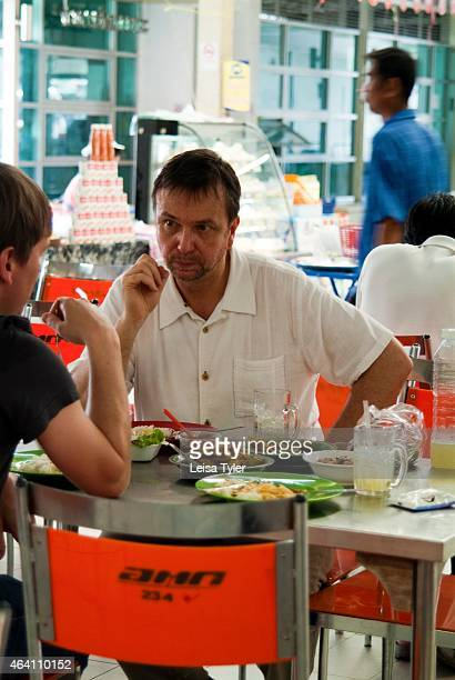 David Thompson lunching at Or Tor Kor Market a fresh food market on the outskirts of Bangkok Thompson an Australian native is widely regarded as the...