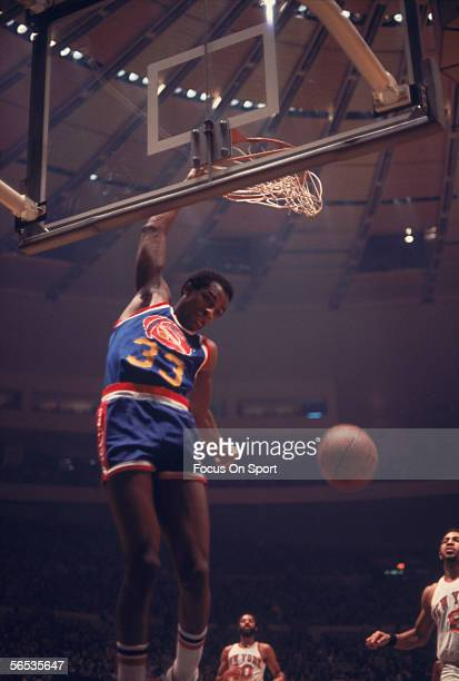 David Thompson of the Denver Nuggets dunks the ball against the New York Knicks circa the 1970's during a game