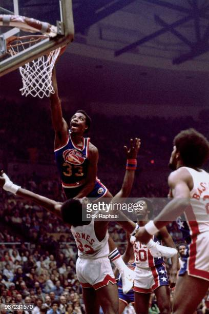David Thompson of the Denver Nuggets dunks the ball against the New York Nets circa 1978 at Nassau Veterans Memorial Coliseum in Uniondale New York...
