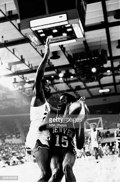 David Thompson of the Denver Nuggets looks to shoot a jump shot against the New York Nets during an ABA game circa 1970 at the Nassau Veterans...