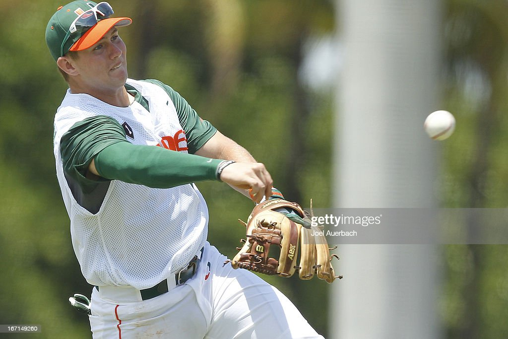David Thompson #19 of the Miami Hurricanes fields the ball hit by Thomas Brittle #4 (not pictured) of the Clemson Tigers on April 21, 2013 at Alex Rodriguez Park at Mark Light Field in Coral Gables, Florida. Miami defeated Clemson 7-0.