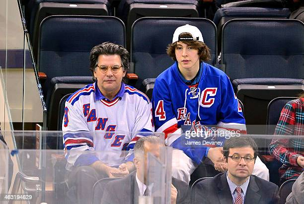 David Thornton and Declyn Wallace Thornton attend the Detroit Red Wings vs New York Rangers game at Madison Square Garden on January 16 2014 in New...