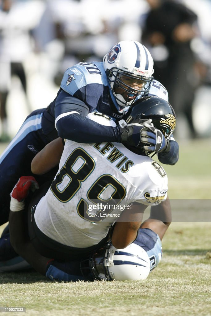 David Thornton of the Titans tackles Marcedes Lewis during 1st-half action between the Jacksonville Jaguars and Tennessee Titans at LP Field in Nashville, Tennessee on December 17, 2006. Tennessee won 24-17.