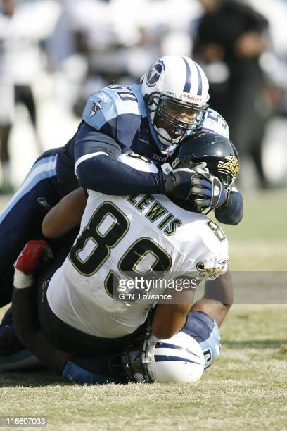 David Thornton of the Titans tackles Marcedes Lewis during 1sthalf action between the Jacksonville Jaguars and Tennessee Titans at LP Field in...