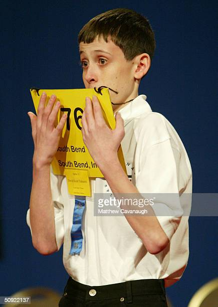 David Tidmarsh of South Bend Indiana peers over his placard after spelling the word gaminerie correctly to advance to round 15 during the National...