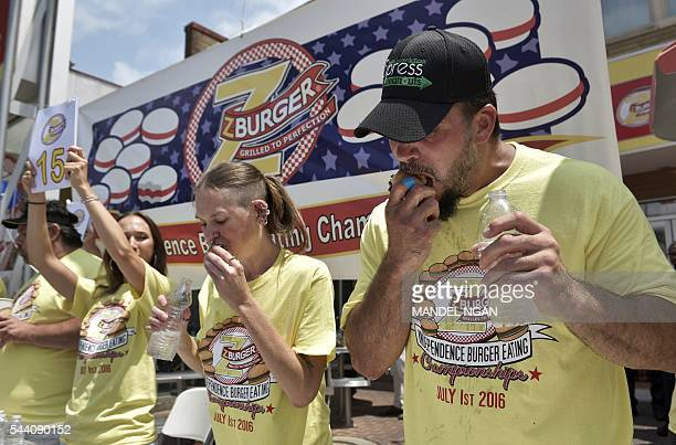 David 'Tiger Wings and Things' Brunelli and Molly Schuyler who won by eating 28 burgers in 12 minutes compete in the Zburger Independence Burger...