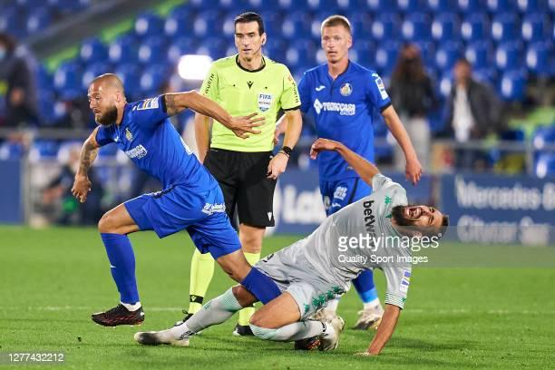 David Timor of Getafe CF battles for the ball with Borja Iglesias of Real Betis during the La Liga Santander match between Getafe CF and Real Betis...