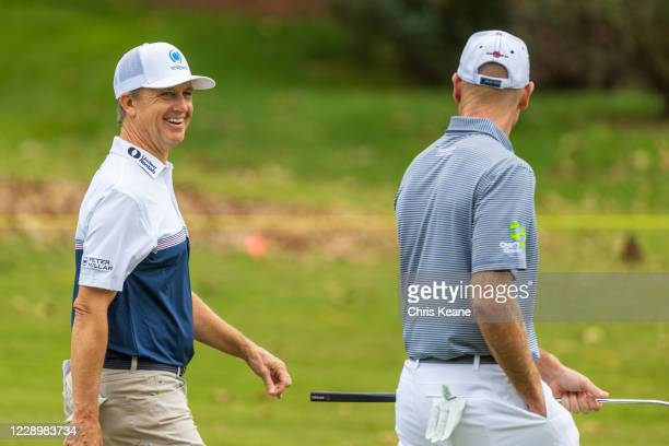 David Toms and Jim Furyk share a laugh as they walk down the sixth hole during the first round of the SAS Championship at Prestonwood Country Club on...