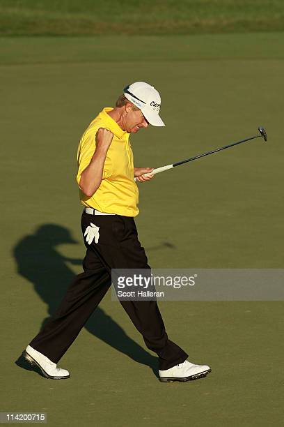 David Toms celebrates making birdie on the 18th hole to force a playoff during the final round of THE PLAYERS Championship held at THE PLAYERS...