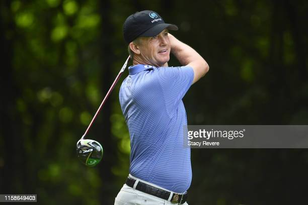 David Toms hits his tee shot on the 11th hole during the first round of the U.S. Senior Open Championship at the Warren Golf Course on June 27, 2019...