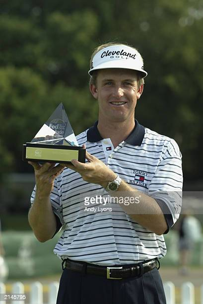 David Toms is pictured with the winner's trophy after winning the Fed Ex St. Jude Classic on June 29, 2003 at the TPC at Southwind in Memphis,...