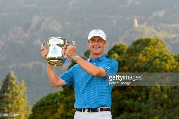 David Toms lifts the winner's trophy after winning the U.S. Senior Open Championship at The Broadmoor Golf Club on July 1, 2018 in Colorado Springs,...