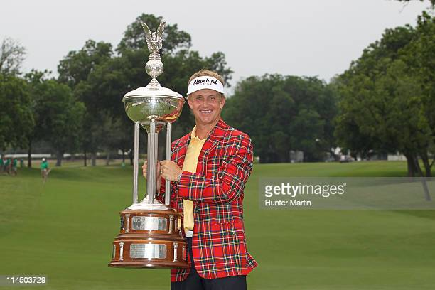 David Toms poses with the championship trophy after winning the Crowne Plaza Invitational at Colonial Country Club on May 22, 2011 in Fort Worth,...