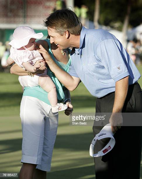 David Toms shares a winning hug with his family after the Sony Open January 15 held at Waialae Country Club Honolulu Hawaii David Toms shot 19 under...
