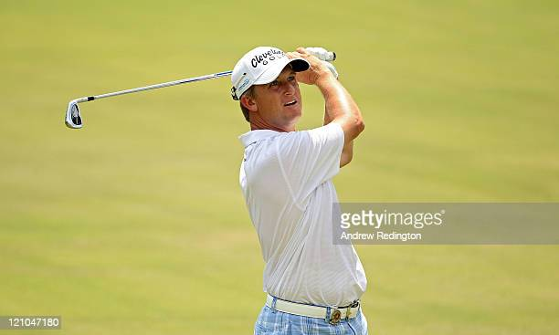 David Toms watches a shot on the 18th hole during the third round of the 93rd PGA Championship at the Atlanta Athletic Club on August 13, 2011 in...
