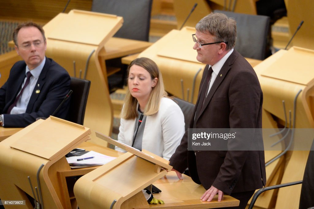 David Torrance (R), SNP MSP for Kirkcaldy, raises the issue of Scottish Government support for engineering company BiFab during Topical Questions in the Scottish Parliament, as the company faces the possibility of going into administration because of difficulties with a major contract, on November 14, 2017 in Methil, Scotland. Unions say staff have agreed to a 'work-in' - continuing to work to progress the orders in hand even though they may not be paid.