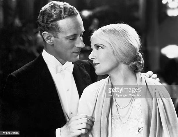 David Trent and Shirley Mortimer gaze into each other's eyes in the 1931 romantic comedy Devotion