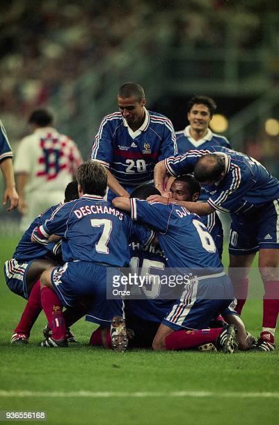 David Trezeguet Bixente Lizarazu Dider Deschamps Lilian Thuram Youri Djorkaeff and Zinedine Zidane of France celebrates the victory during the Soccer...