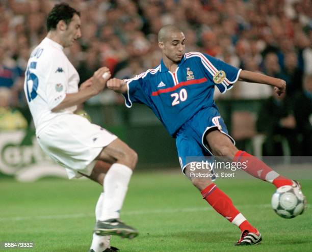 David Trezeguet of France scores the golden goal in extra time of the UEFA Euro 2000 Final between France and Italy at the Feijenoord Stadium on July...