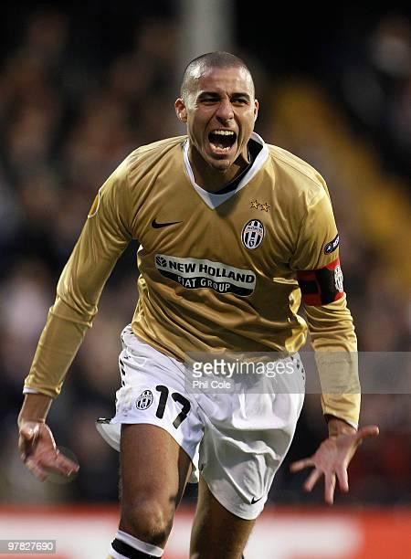 David Trezeguet of Juventus celebrates scoring the opening goal during the UEFA Europa League Round of 16 second leg match between Fulham and...