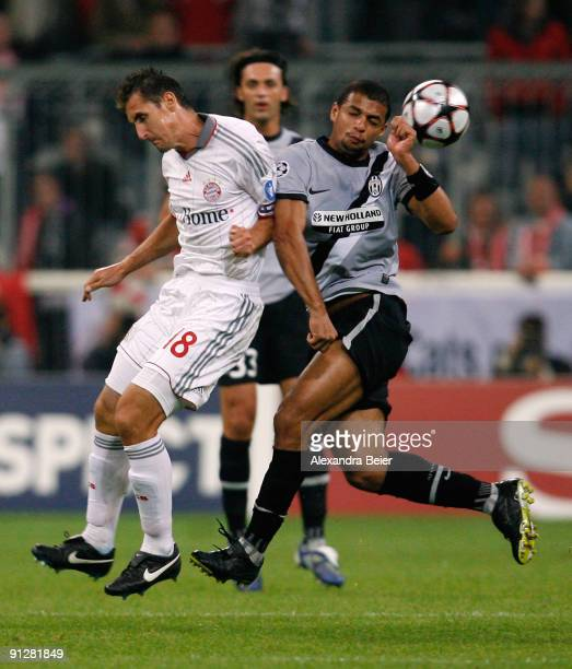 David Trezeguet of Juventus challenges Miroslav Klose of Muenchen during the UEFA Champions League Group A match between FC Bayern Muenchen and...
