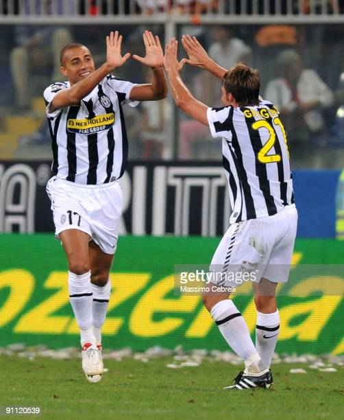 David Trezeguet of Juventus FC celebrates scoring his team's second goal with his teammate Zdenek Grygera during the Serie A match between Genoa CFC...