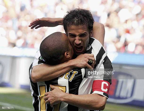 David Trezeguet of Juventus is congratulated by Alessandro Del Piero after scoring during the Serie A match between AC Milan and Juventus played at...
