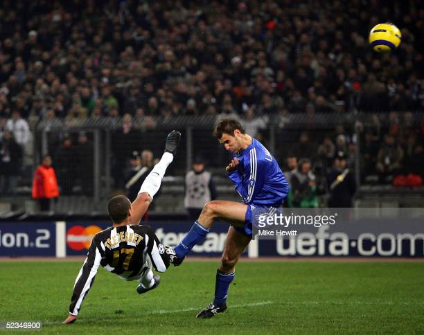 David Trezeguet of Juventus scores with a spectacular overhead kick which Ivan Helguera of Real Madrid cannot block during the UEFA Champions League...