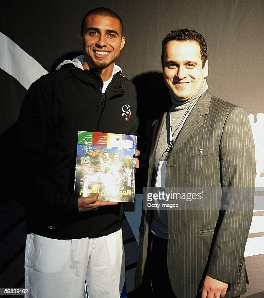 David Trezeguet poses with a journalist during the Major adidas F50 Tunit Launch Event on February 13 2006 in Munich