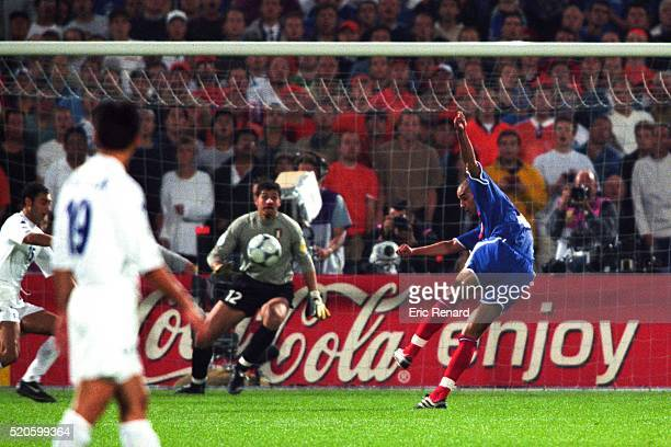 David Trezeguet shoots into the top corner and scores the 'Golden Goal' to win the game and the title and Francesco Toldo Goalkeeper of Italy during...
