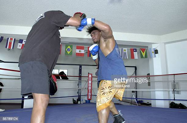 David Tua hits the pads held by trainer Ronnie Shields during training in the Gym at Prince Ranch Resort Mt Charleston north of Las Vegas Tua is...