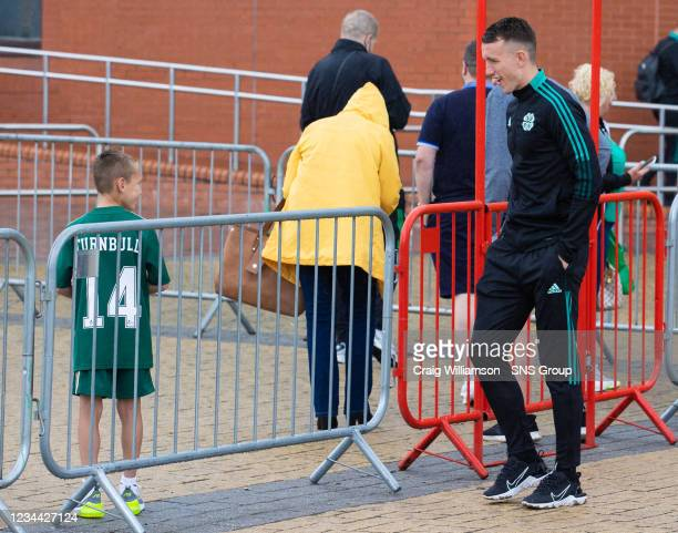 David Turnbull is pictured with a young supporter as Celtic depart for their Europa League tie against Jablonec, at Celtic Park, on August 03 in...
