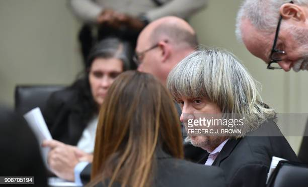 David Turpin confers with attorneys Allison Lowe and David Macher as Louise Turpin confers with attorney Jeff Moore during his court arraignment with...