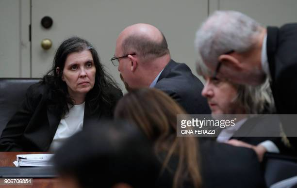 David Turpin confers with attorneys Allison Lowe and David Macher as Louise Turpin confers with attorney Jeff Moore during their court arraignment in...