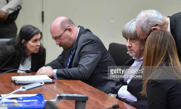 David Turpin confers with attorneys Allison Lowe and David Macher as his wife Louise Turpin confers with attorney Jeff Moore during their court...