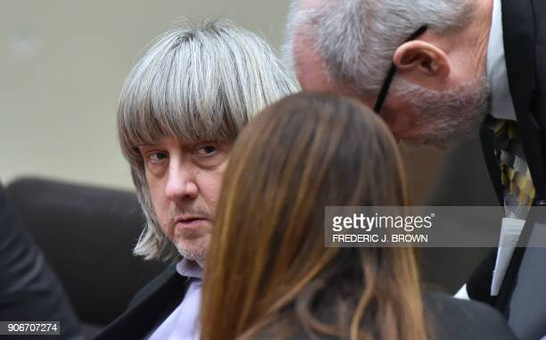 David Turpin confers with attorneys Allison Lowe and David Macher during his court arraignment with wife Louise Turpin in Riverside California on...