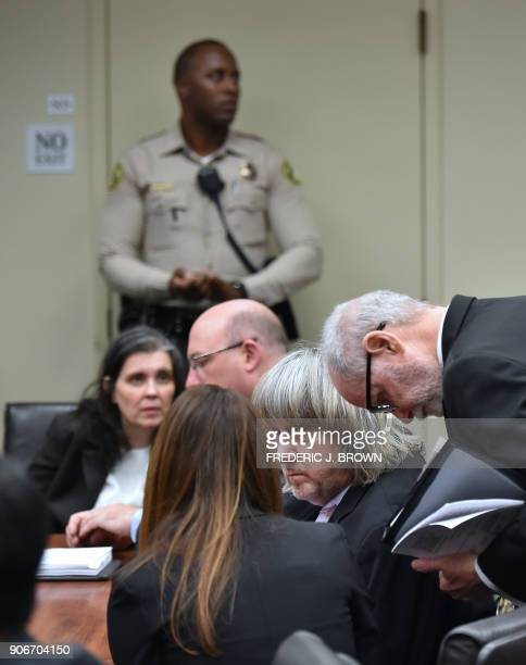 David Turpin listens to attorneys David Macher and Allison Lowe as Louise Turpin confers with her attorney Jeff Moore during their court arraignment...