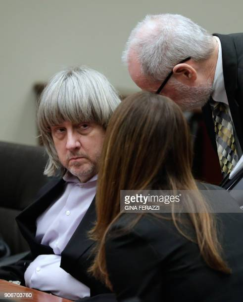 David Turpin listens to attorneys David Macher and Allison Lowe during their court arraignment in Riverside California on January 18 2018 The...